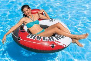 girl enjoying her inner tube float in pool